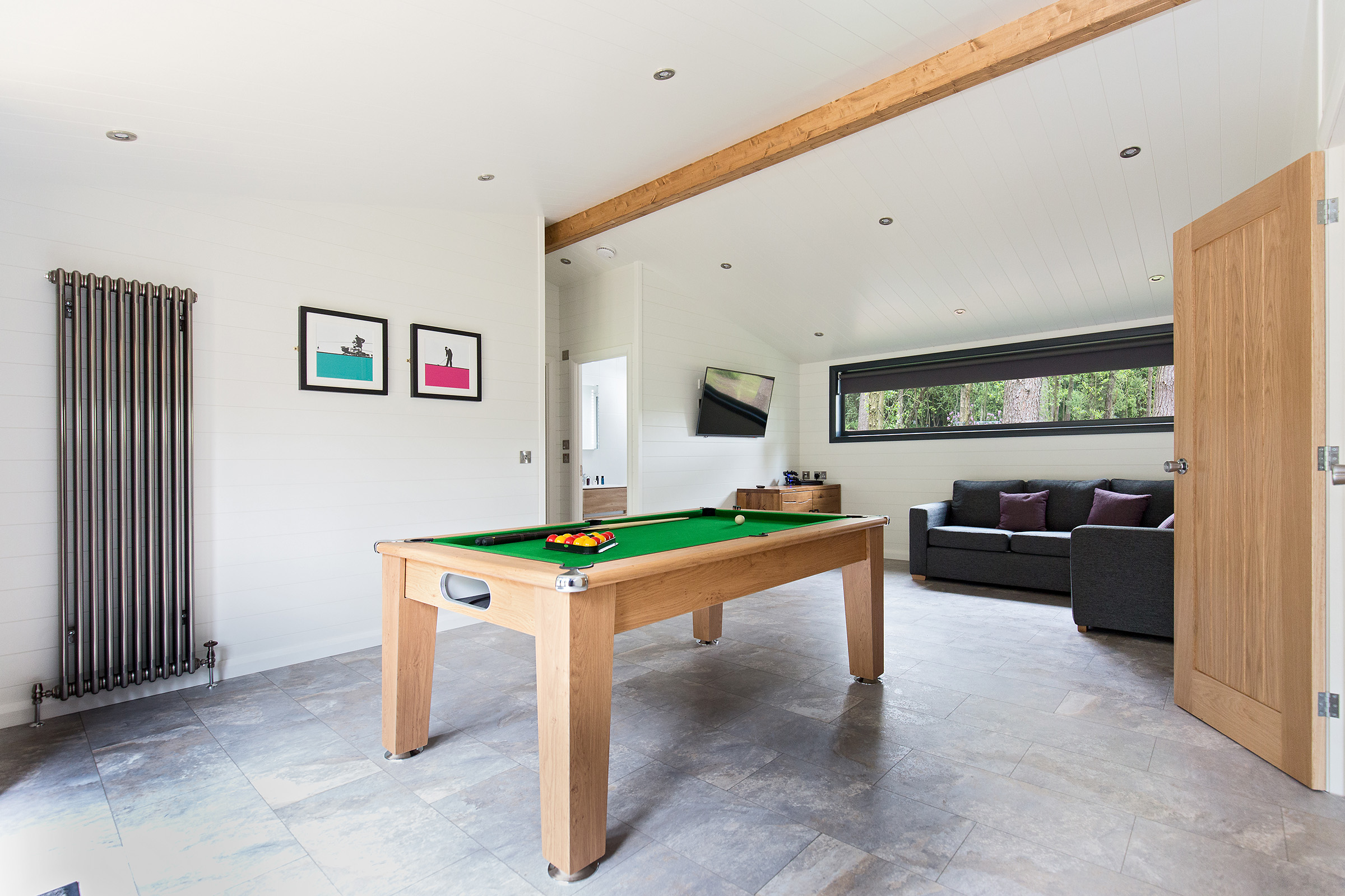 The Glade Timber Lodge — Games room with pool table