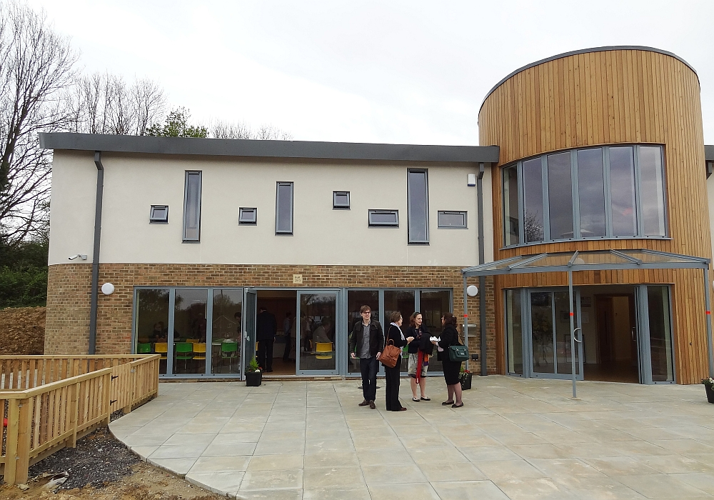 Community centre and church - exterior with people outside