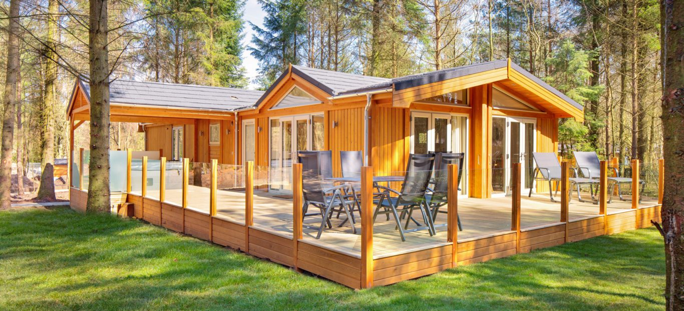 Timber lodge in a sunny forests setting