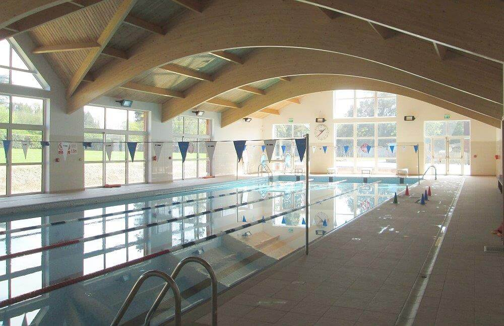 indoor swimming pool with lanes set up for swimmers