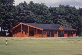 External view of College Pines Golf Club Clubhouse