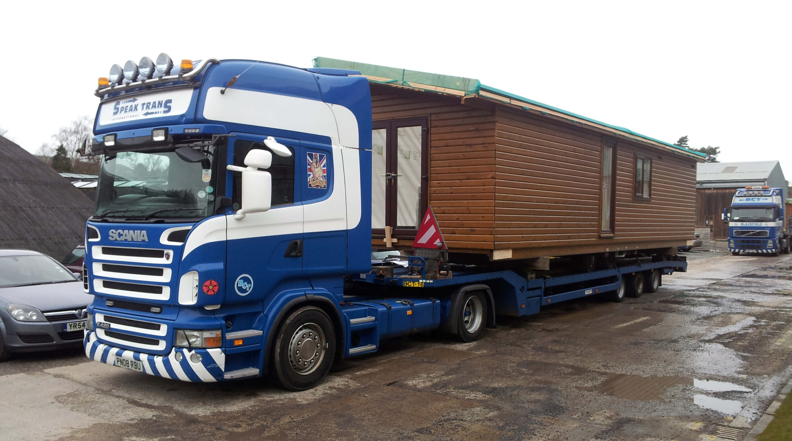 Pinelog lodge on a transportation lorry ready for delivery