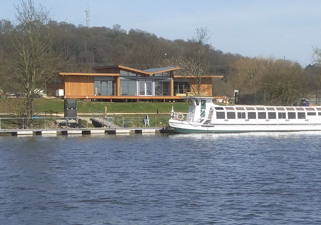 A view of the Princess River Cruises facilities building from accross the river