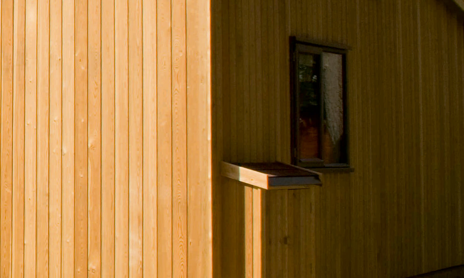 Vertical shiplap larch cladding